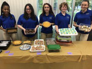 Cortona Academy students baking
